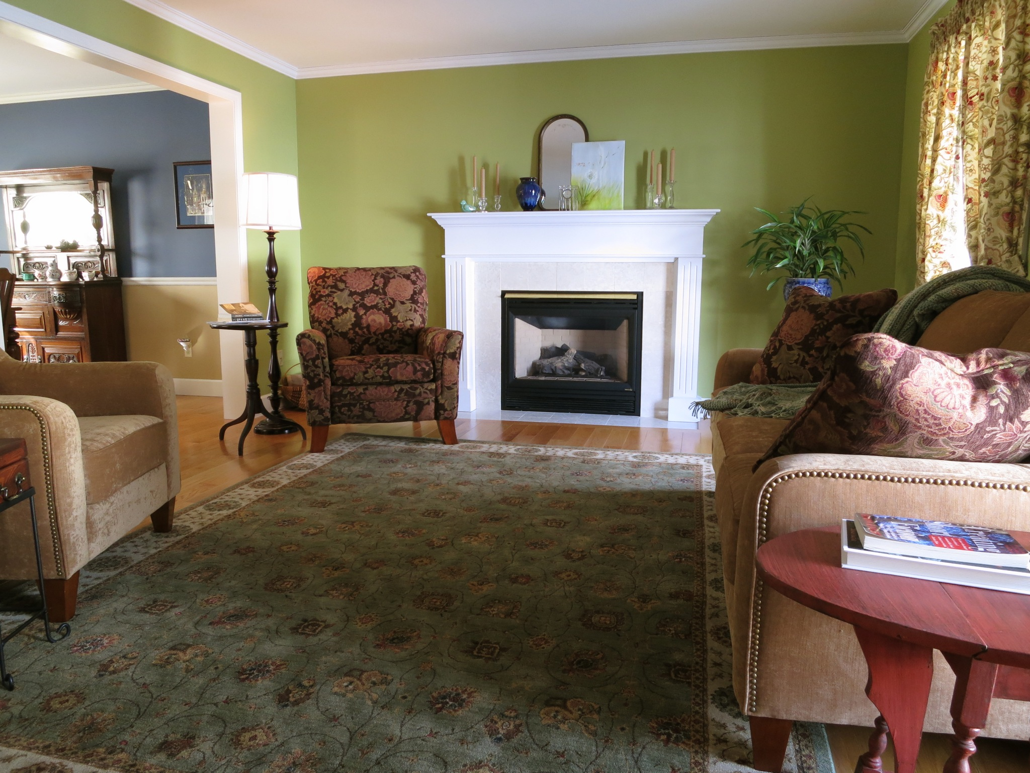 The living room, like every room on the lower level, offers crown moldings and deep baseboards. It also features a gas fireplace with marble tile surround.