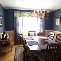 The dining room offers a chair rail in addition to crown moldings.