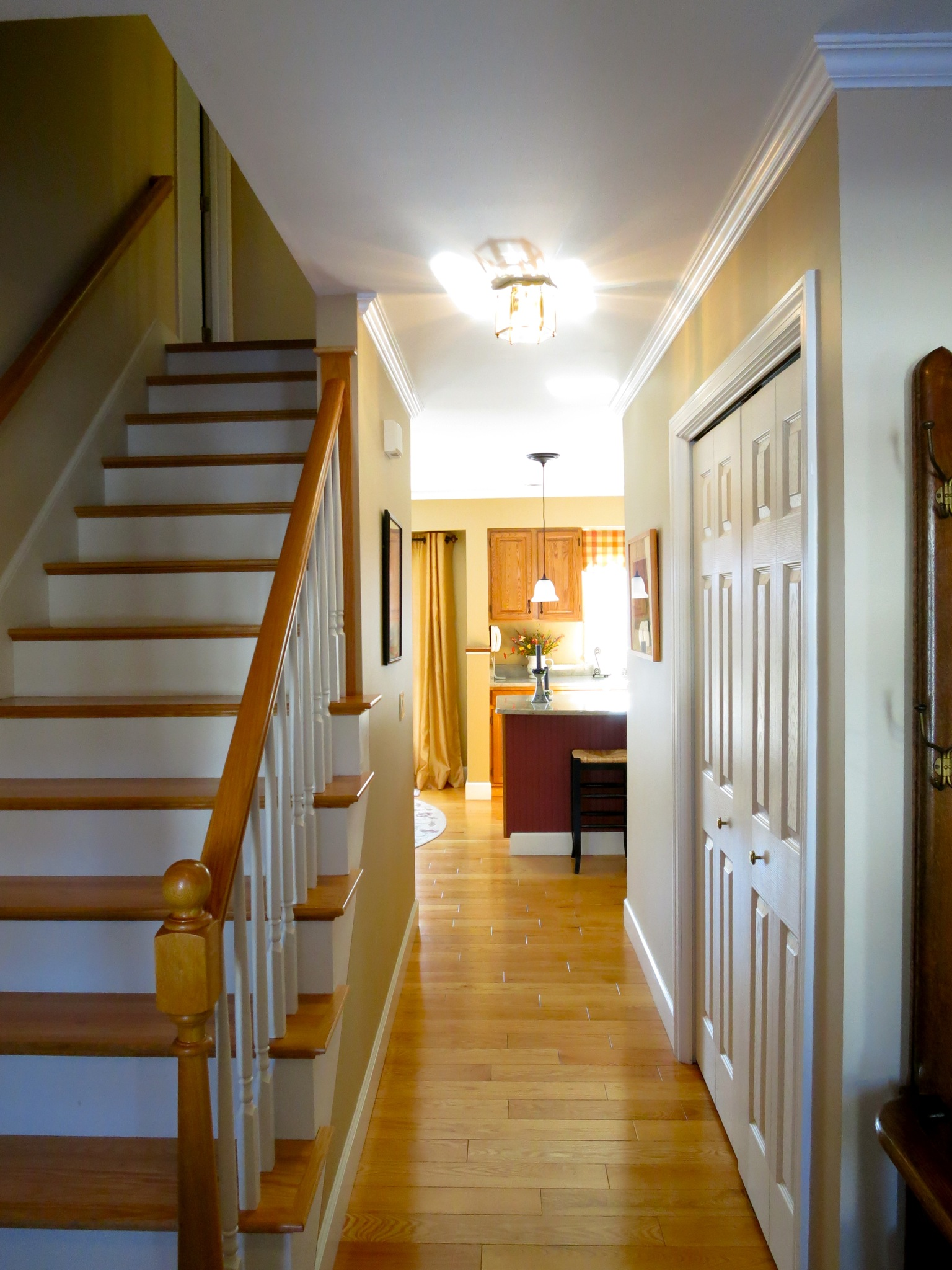 Hallmark of this style of home, the center hall offers a view through from front door to kitchen.