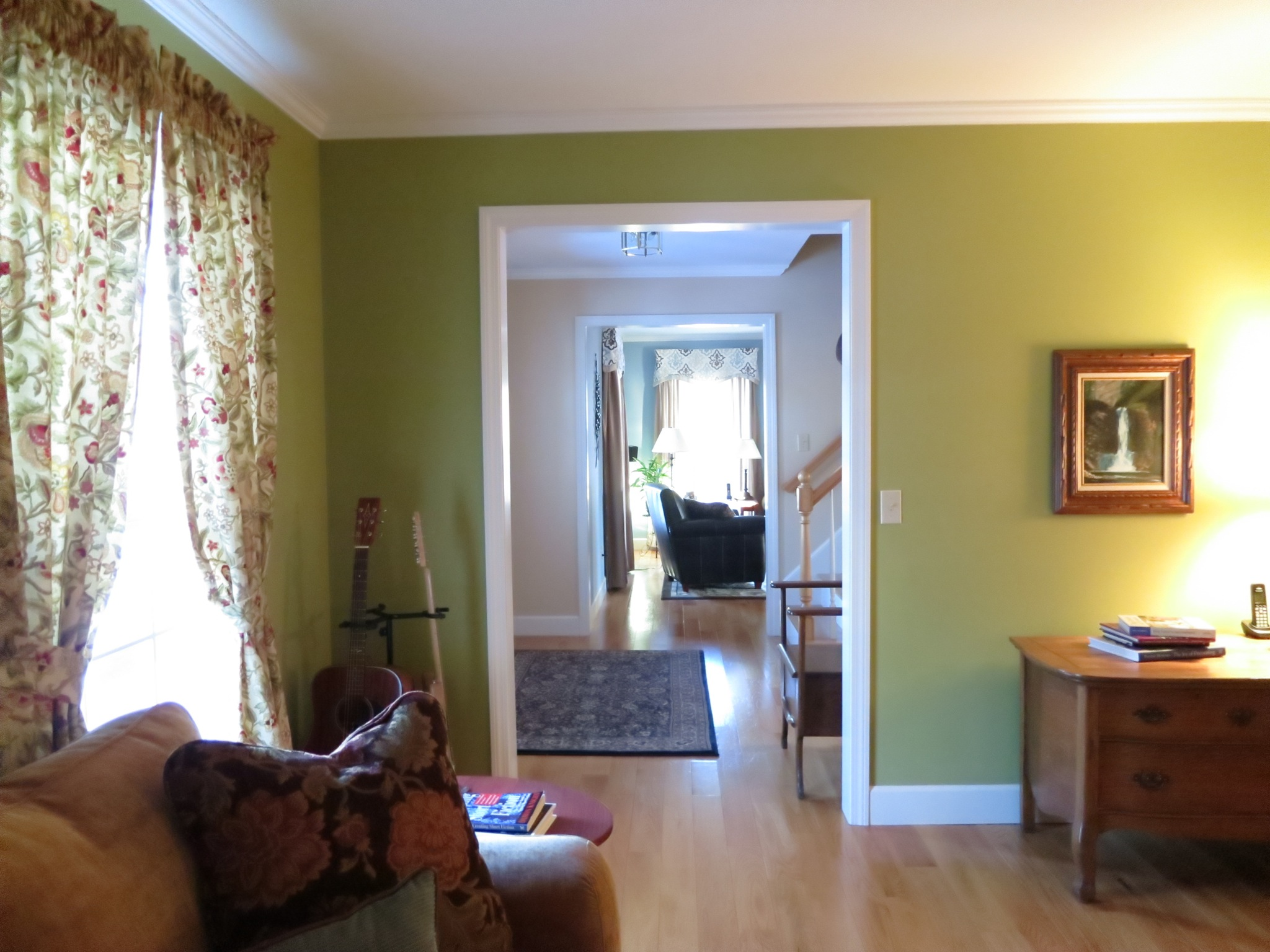 Thoughtful sight-lines abound: this one provides a view-through from the living room to the family room.