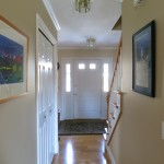 The hall also features a roomy closet and gallery walls.