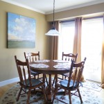 The breakfast nook is the sunniest spot in the house, and features brand new, energy efficient Anderson &quot;Frenchwood&quot; gliding doors.