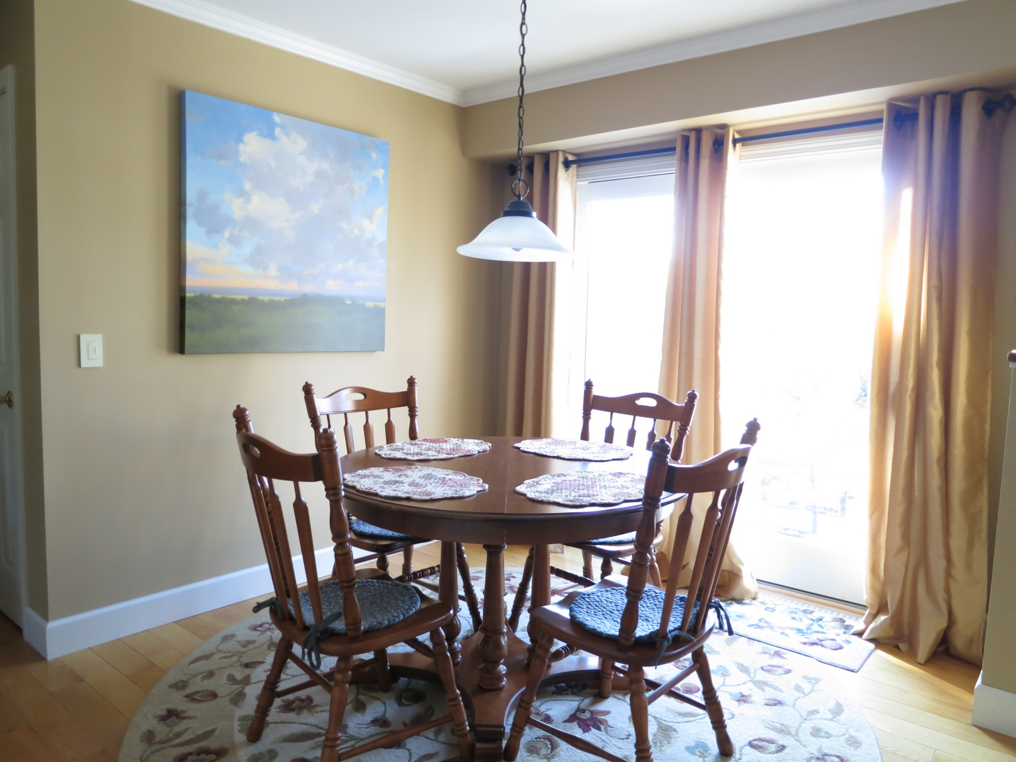 """The breakfast nook is the sunniest spot in the house, and features brand new, energy efficient Anderson """"Frenchwood"""" gliding doors."""