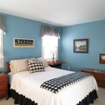 The roomy guest  bedroom offers guests privacy and comfort and boasts a closet organizer.