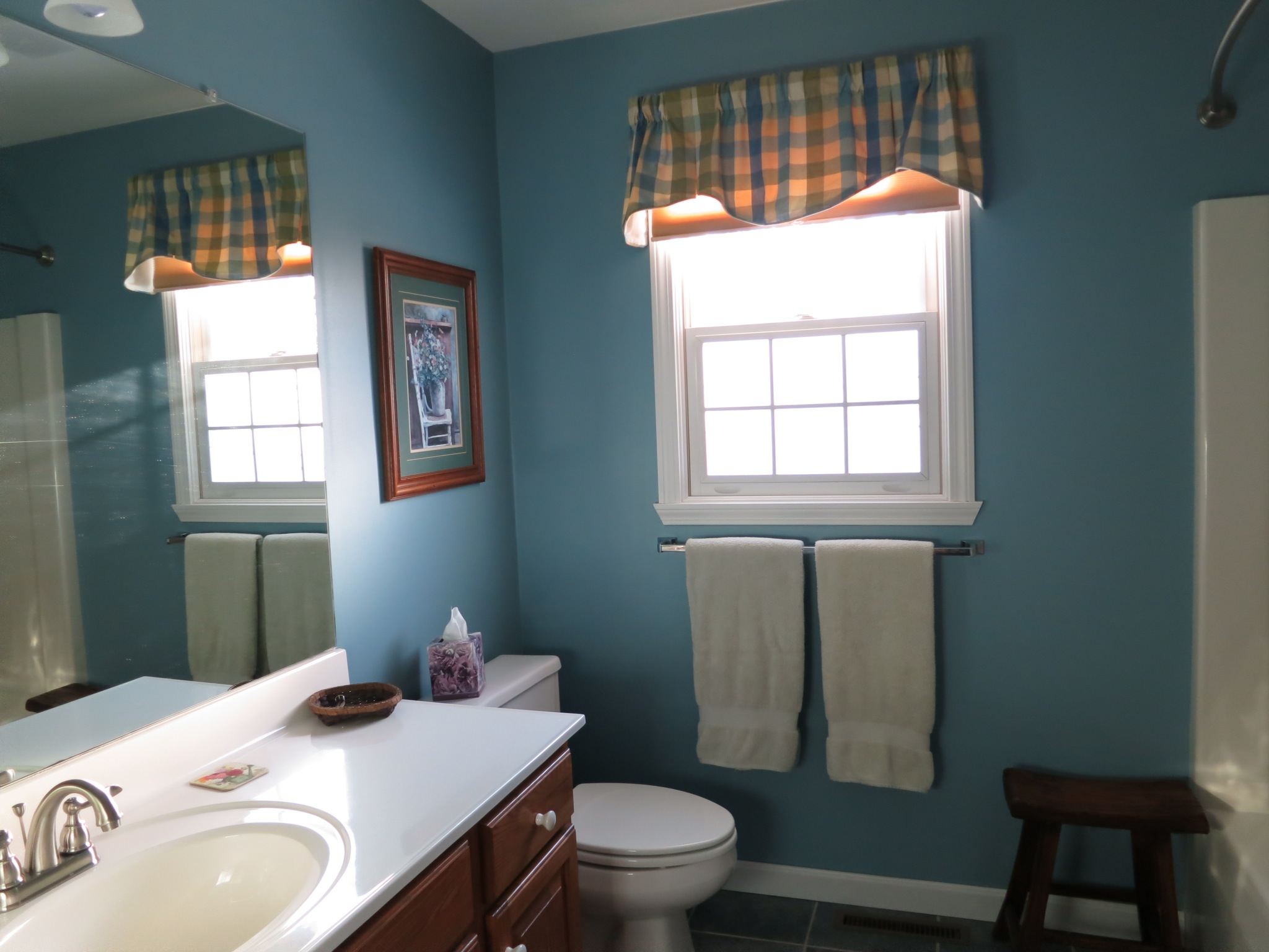 The roomy upstairs bath offers an integrated tub / shower surround, and handy closet space.