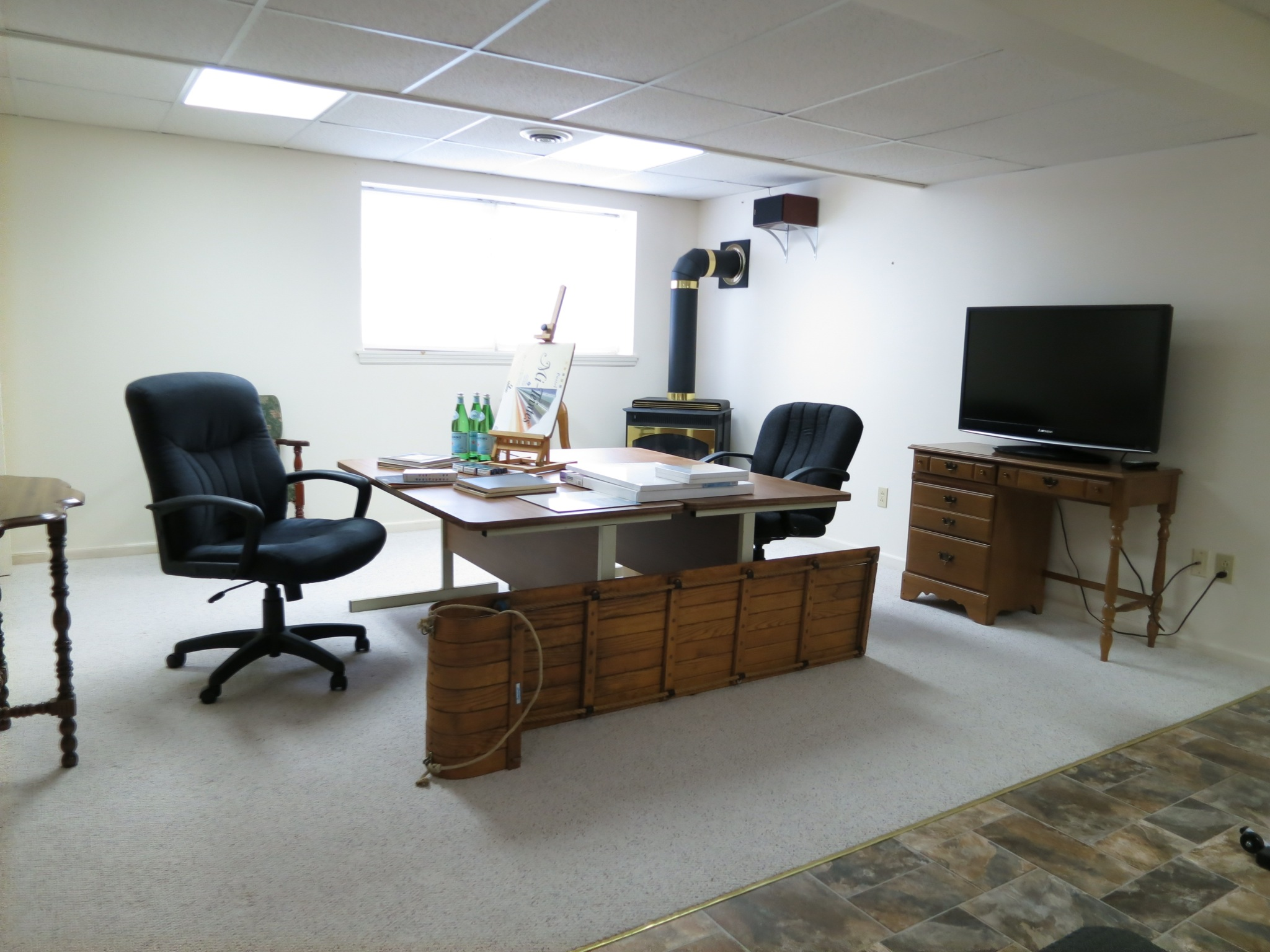 The lower level offers unfinished mechanicals / storage / workspace and a finished bonus area.